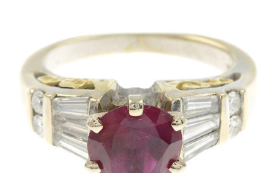 A glass-filled ruby and diamond bi-colour ring.