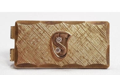 A gold plated Money clip set with two diamonds.