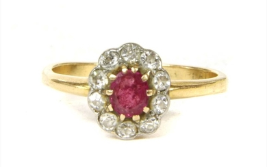 A gold ruby and diamond cluster ring