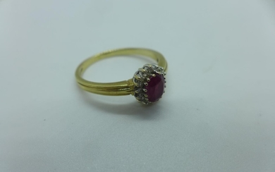 A hallmarked 9ct yellow gold ruby and white stone ring, size...