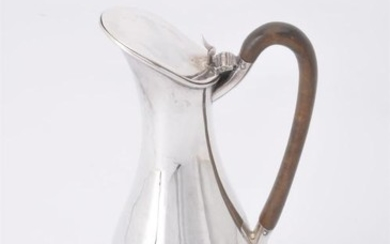 A late Victorian silver elongated baluster hot water jug by Joseph Rogers and Sons
