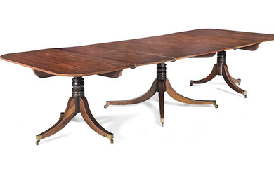 A mahogany triple pedestal dining table