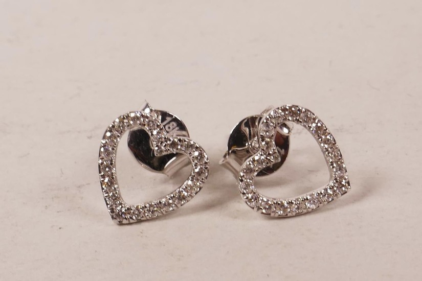 A pair of 18ct white gold, heart shaped diamond earrings