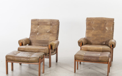 A pair of 1970/80:s easy chairs with stools
