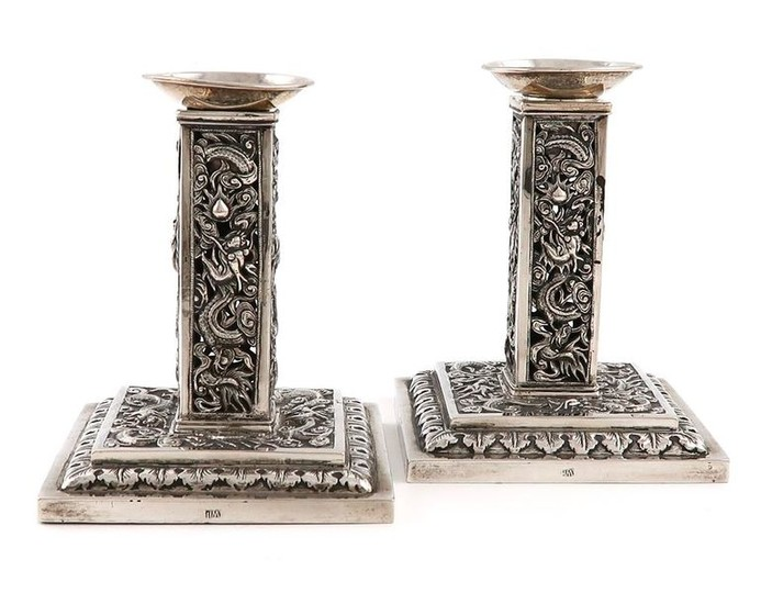 A pair of Chinese silver candlesticks, by Wang...