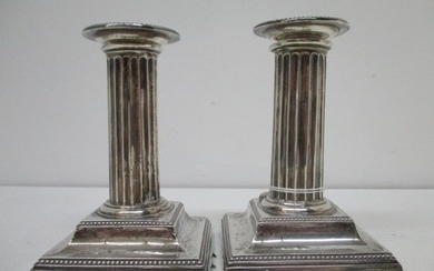 A pair of Victorian silver candlesticks by Hawksworth, Eyre ...