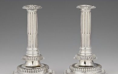 A pair of William & Mary silver candlesticks