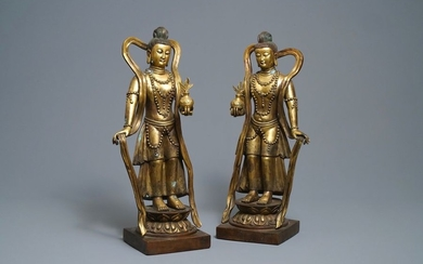 A pair of large Chinese gilt bronze figures,...