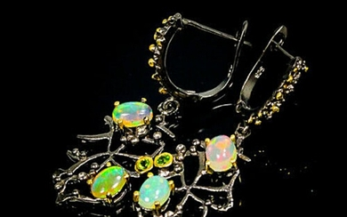 A pair of opal and tourmaline ear pendants each set with numerous opals and tourmalines, mounted in rhodium and gold plated sterling silver.