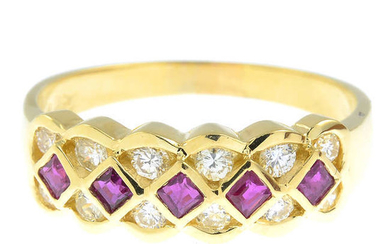 A ruby and diamond band ring.