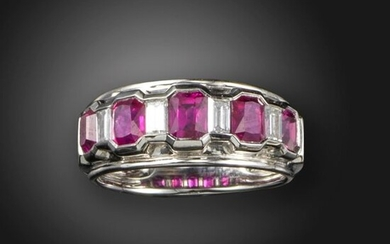 A ruby and diamond half-hoop ring, alternately channel-set with rectangular-shaped rubies and baguette-shaped diamonds in platinum, size O
