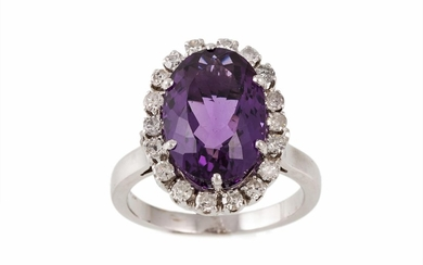 AN AMETHYST AND DIAMOND CLUSTER RING, the amethyst estimated...