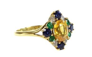 An 18ct gold, yellow sapphire, blue sapphire, emerald and diamond cluster ring