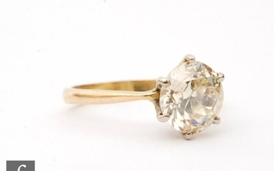 An 18ct hallmarked diamond solitaire ring, claw high set old...
