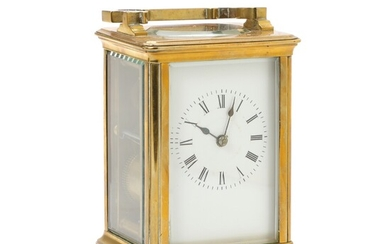 An English carriage clock, original travel case is enclosed. Late 19th century. H. 14 cm....
