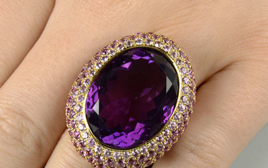 An amethyst and graduated pink sapphire dress ring.