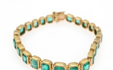 An emerald bracelet set with numerous emerald-cut emeralds weighing a total of app. 18.0 ct., mounted in 18k gold. L. 17.5 cm.