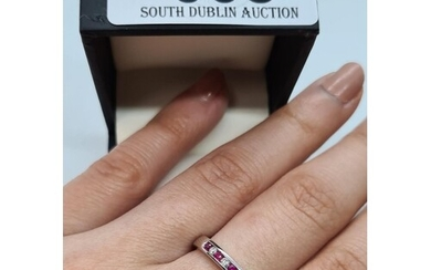 Brand new 9ct white gold diamond and ruby eternity ring, siz...