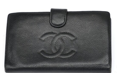 Chanel: A wallet made of black Caviar leather with gold toned hardware, a press button,...