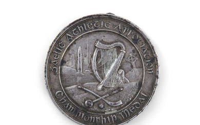 Description A RARE AND EARLY GAA MEDAL, c.1885, the...