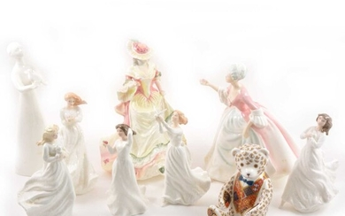 Eight Royal Doulton figurines, plus a Royal Crown Derby paperweight bear.