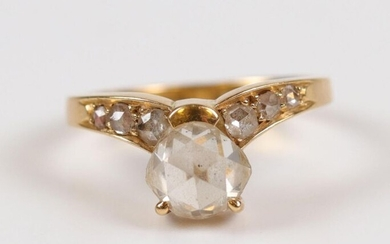 Gold ring (750) half cushion cut diamond (about 0.90 ct)...