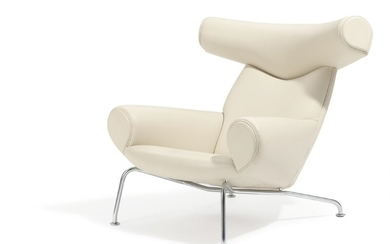"""Hans J. Wegner: """"Ox Chair"""". Easy chair with steel frame, upholstered with off-white leather. Manufactured by Erik Jørgensen."""