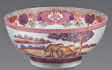 Large porcelain bowl. Qianlong, 18th century. Decorated with enamels of the Rose Family, outside buffaloes and deer in lake landscapes and bunches of flowers in turquoise flower cartridges a sgraffito between two braids, the inside edge of a large...