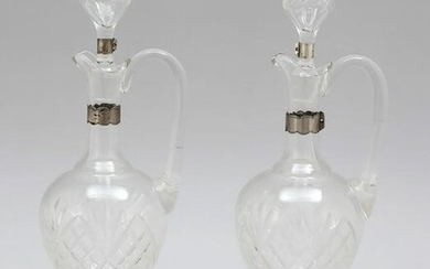 Pair of carafes with silv