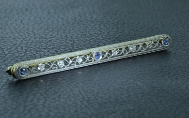 Platinum on 14 KT Yellow Gold Bar Pin set with Diamond