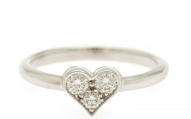 Tiffany & Co.: A heart ring set with three brilliant-cut diamonds, mounted in platinum. Size 50.