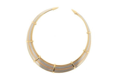 * Torque-type choker made of ten separate 18k (750 mils) yellow and white gold wires held by yellow gold loops and ending with two rounded and screwed bites. Nice flexibility.