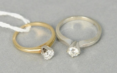 Two 14 karat yellow gold and diamond engagement rings