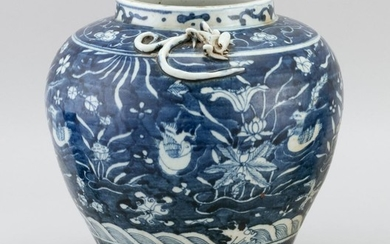 UNUSUAL CHINESE WHITE-ON-BLUE PORCELAIN JAR In inverted pear form, with qilong dragons at shoulder and decoration of mandarin ducks...