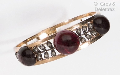 "Yellow gold and silver ""Jonc"" bracelet, set with three garnet..."