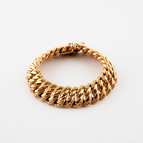 Yellow gold bracelet (750) with partially filed American...