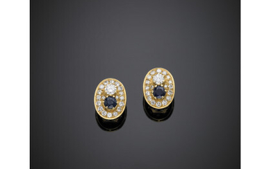 Yellow gold diamond and sapphire earrings, the central diamonds ct....