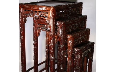 20th century Chinese nest of four hardwood tables, carved ed...