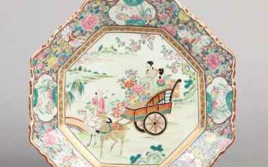 A 19th century Chinese scalloped octagonal charger. Painted ...