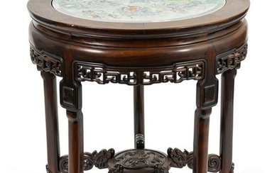 A Chinese Carved Rosewood Center Table with Famille