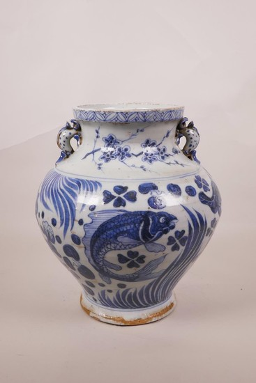 A Chinese blue and white Ming style pottery vase with two dr...