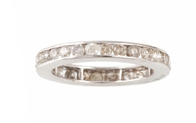 A DIAMOND ETERNITY RING, the channel set diamonds estimated ...