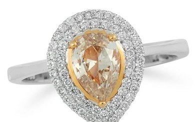 A FANCY DIAMOND CLUSTER RING set with a pear cut fancy