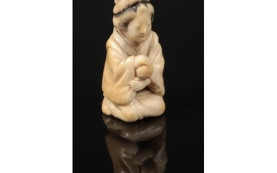 A Japanese Meiji period carved ivory small okimono. Formed a...