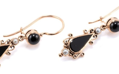 A PAIR OF EDWARDIAN STYLE ONYX AND PEARL DROP EARRINGS; drop shape onyx plaques to 9ct gold frames set with seed pearls and locking...