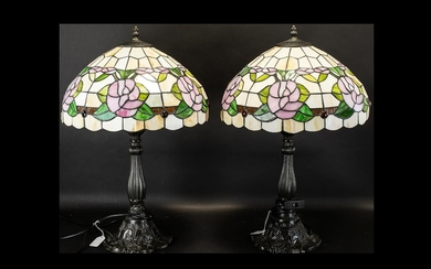 A Pair Of Reproduction Tiffany Style Table Lamps each raised...