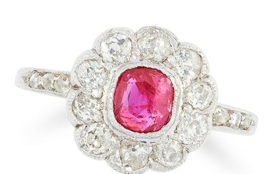 A RUBY AND DIAMOND CLUSTER RING set with a cushion cut