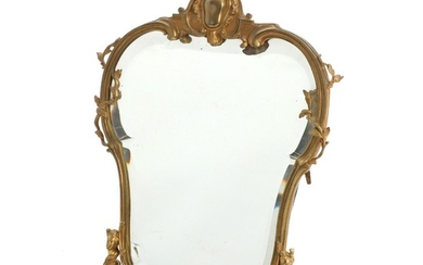 A Rococo style table mirror in a bronze frame, cast with female faces, foliage and c-scrolls. Circa 1900. H. 39 cm.