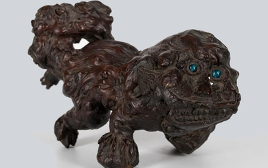 A Rootwood Lion Form Paperweight, Qing Dynasty.