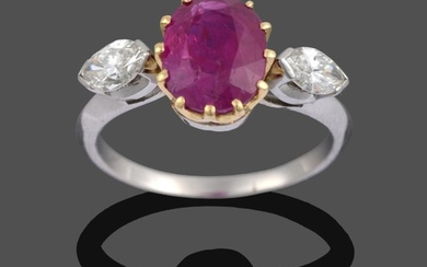 A Ruby and Diamond Three Stone Ring, the oval cut...